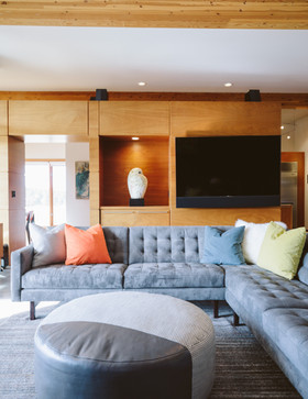 This architecturally stunning home requires a unique furniture configuration to maximize seating for entertaining and soaking in the sweeping views of the Cascade mountain range. The custom U-shape sectional provides an intimate, yet expansive arrangement for lounging and conversation.