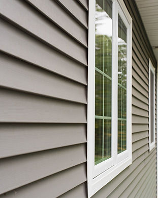stock-photo-vinyl-siding-and-windows-on-side-of-new-home-724975048-1920w_edited.jpg