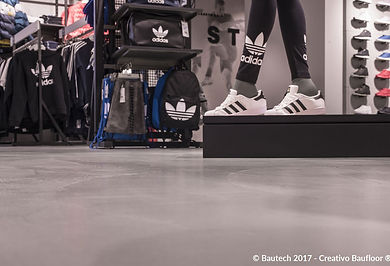 Bautech Flooring UK,Polished Concrete Floor in Adidas shop,Installation microcement floor finish,Microcement Supplier in UK,