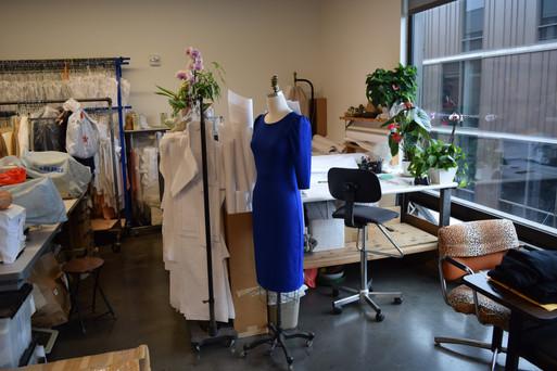 Adjusting dress on mannequin