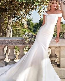 Modern off shoulder wedding dress at Rebecca's