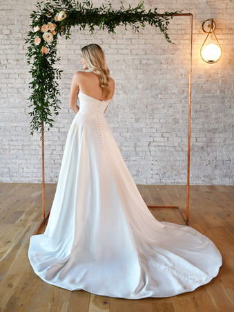 7045 by Stella York    SIMPLE STRAPLESS WEDDING GOWN WITH POCKETS