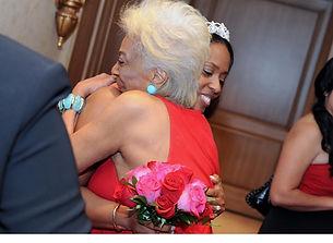 Nichelle Nichols gives hug to Angelique Fawcette at her Wedding.