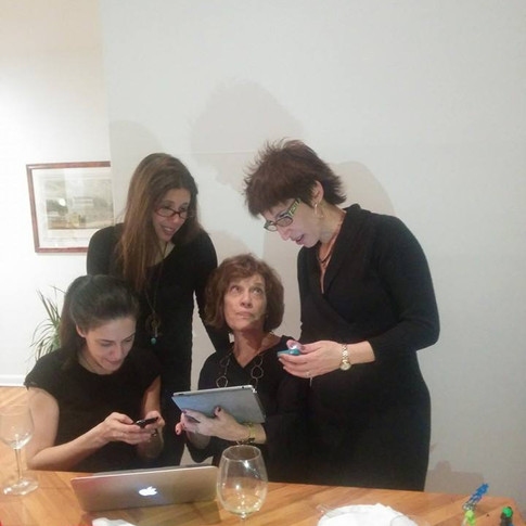 Staring at screens with my mom and two older sisters.