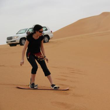 Sandboarding in the Dubai desert.