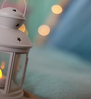 A closeup of a lantern with a tealight c