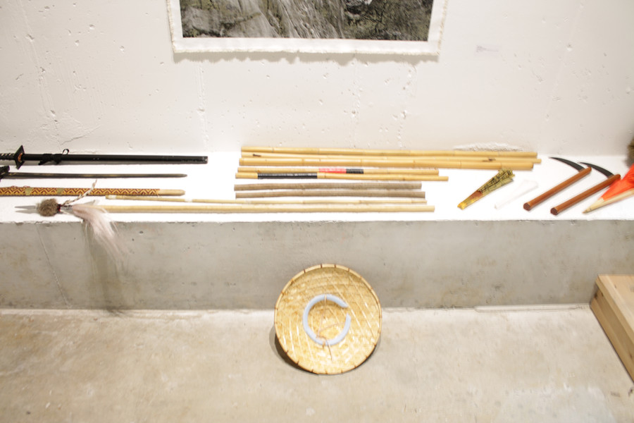 Some of the weapons used in the live show: sword, long staff, fan, and the kama, a rice-farming tool turned weapon.