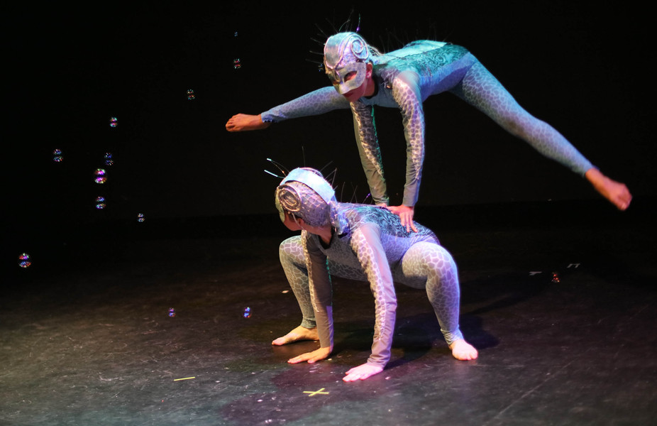 Two creatures appear from out of the fifth dimension, communicating with playful banter and childlike joy.