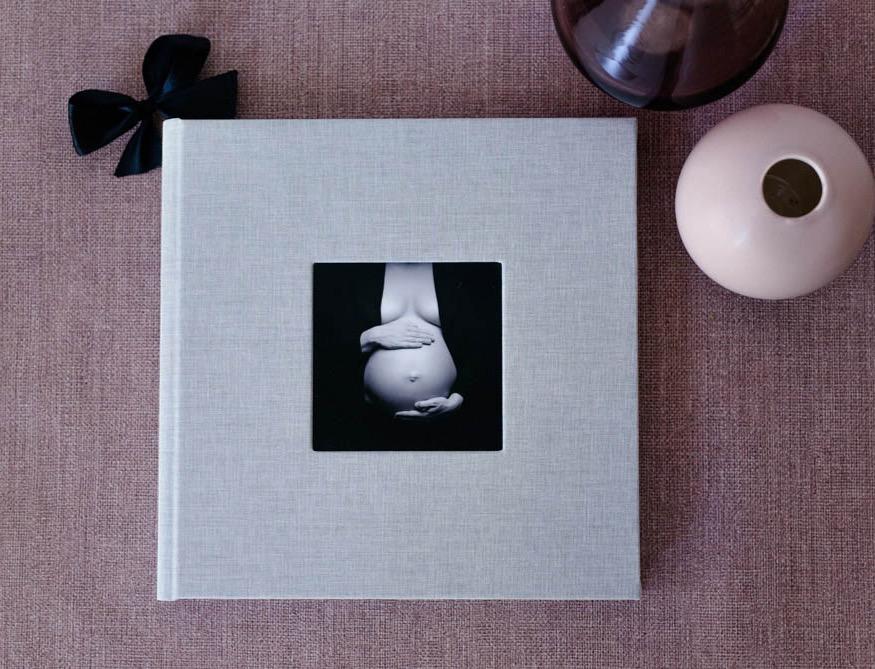 Fotoalbum mit Babybauchfotos