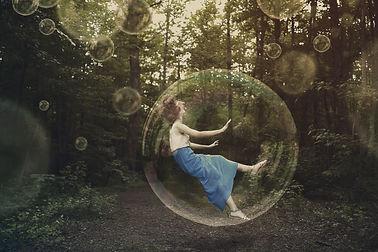 a-woman-is-falling-and-stuck-inside-a-bubble_SmK-QkMgC.jpg