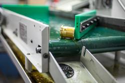 Parts exiting CNC Lathe