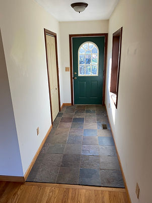 Slate tile entry of the farmhouse for sale.