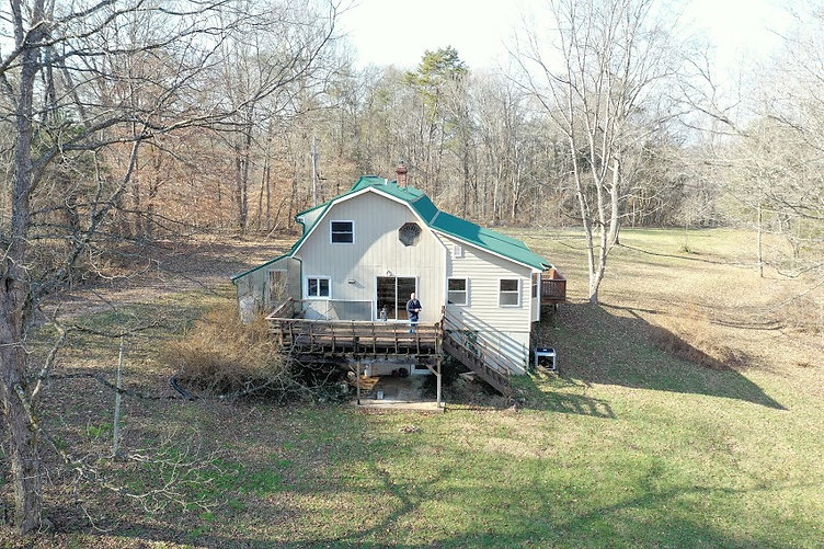 Drone photo of house for sale on 46 acre farm.