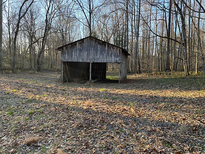 Front view of the barn on the farm for sale.