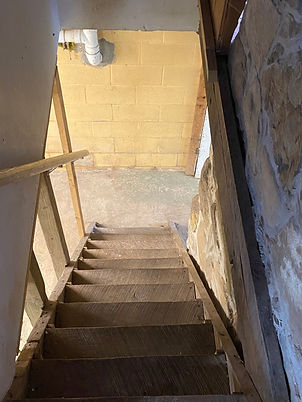 A picture of the stairs down to the basement.