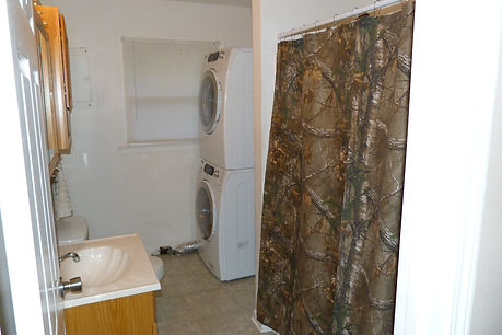 The bathroom with washer and dryer at the lodge.  Come hunt huge Kentucky bucks with no pressure.