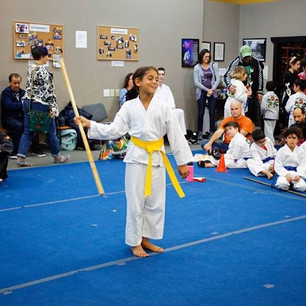Nyah performs her staff swings at the to
