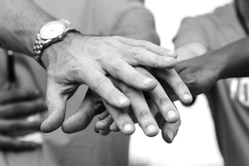 team-of-volunteers-stacking-hands_edited.jpg