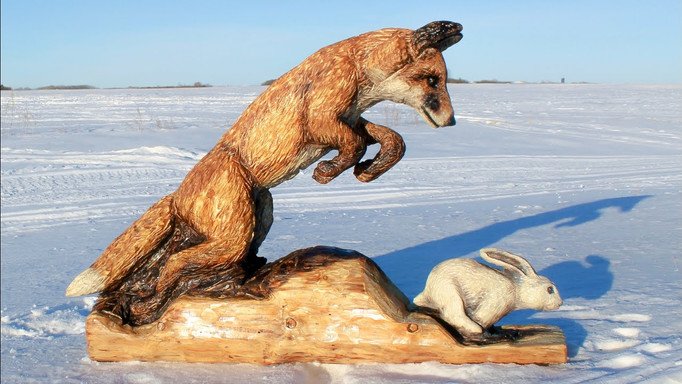 """""""Survival"""" - Fox and Rabbit Chainsaw and Power Tool Carving by Michelle Thevenot Artwork"""