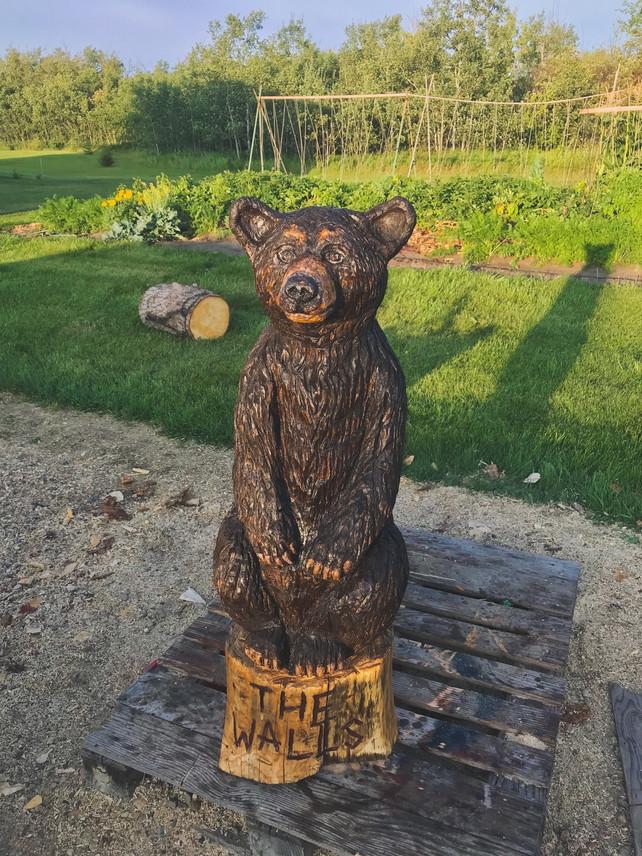 Black Bear Sitting Last Name Sign  Log Sculpture - Michelle Thevenot Artwork - Saskatchewan Chainsaw Carver
