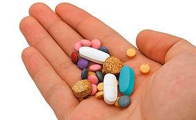 pills in hand .jpg