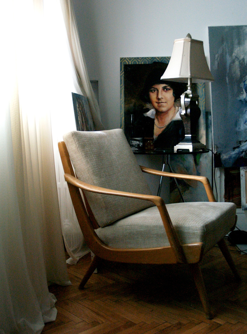 Interior corner of tea table with vintage armchair and portrait.JPG