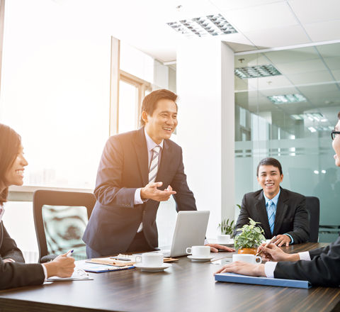 Positive Asian business team having meet