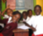 Image of school children at a desk at Circle of Peace School in Uganda
