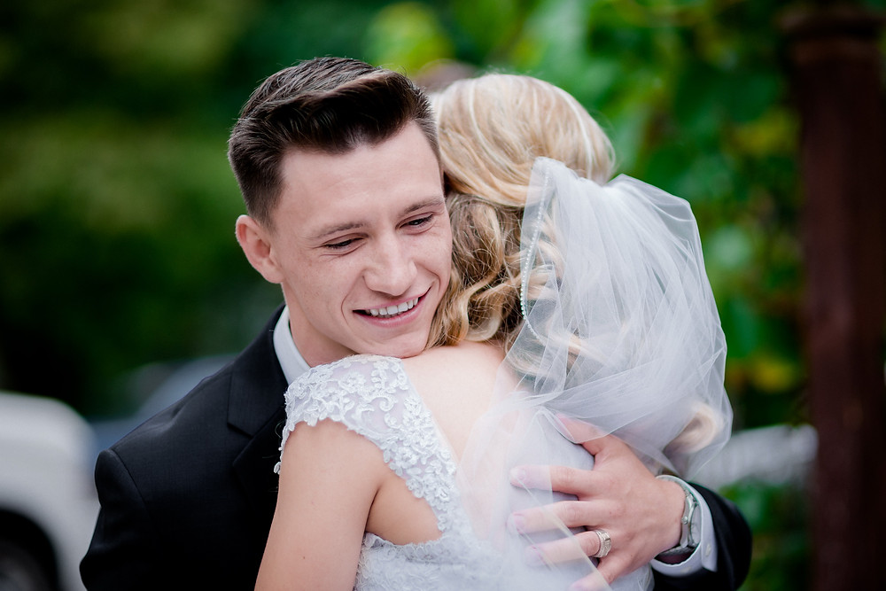 bride and groom hug, close up shot