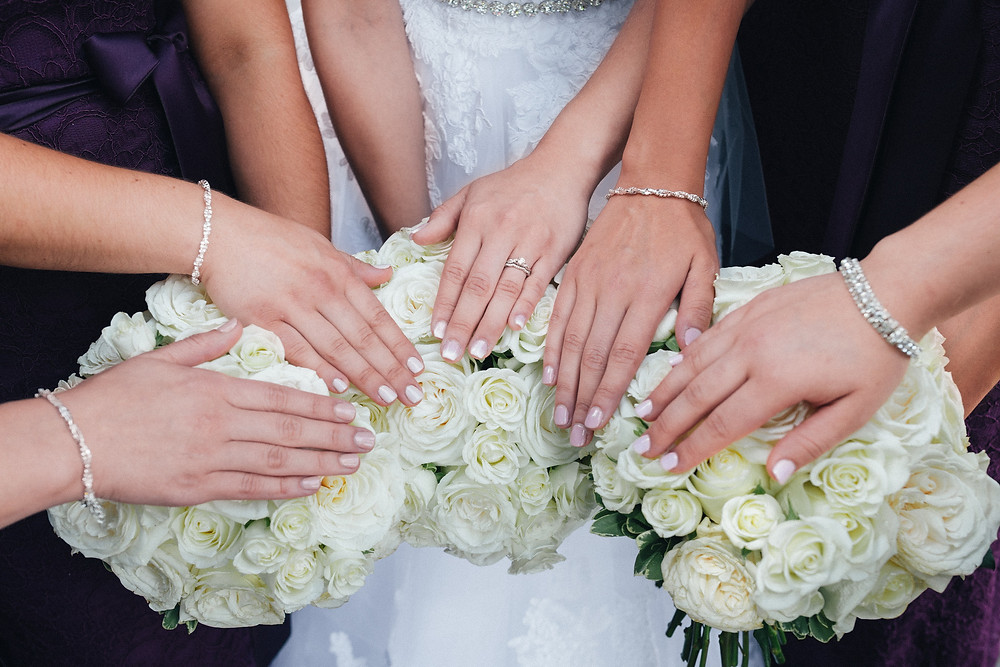 bridal party, girls hands on the bouquet