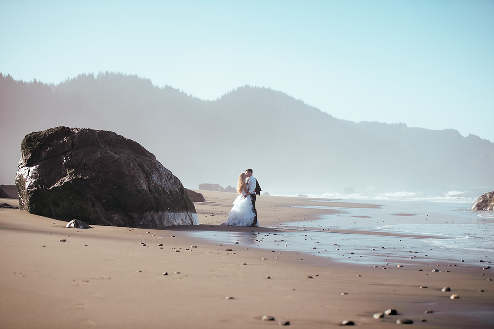 sunrise beach photo of wedding couple