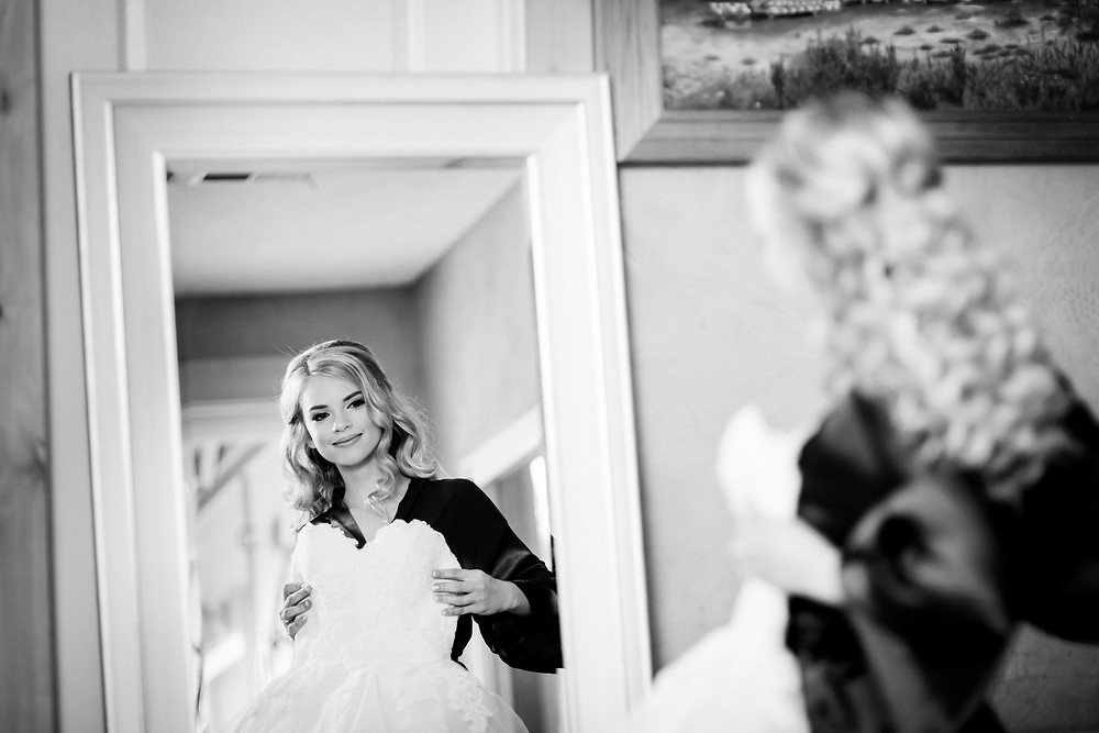bride looks in a mirror