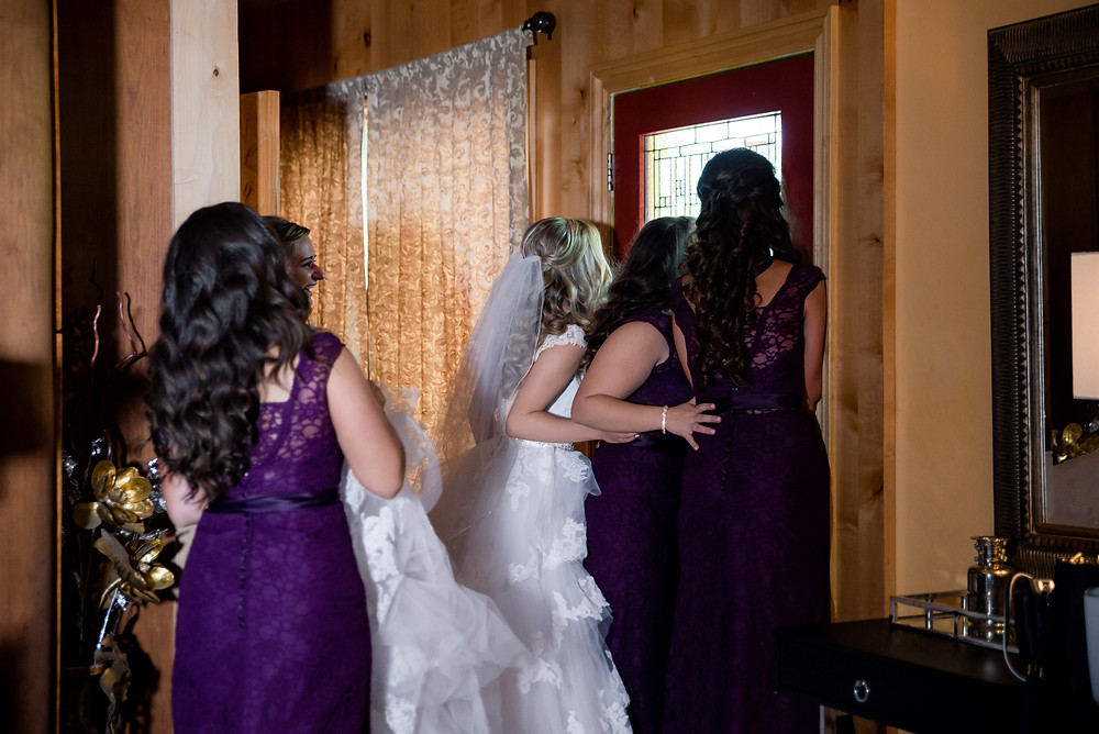 Bride peeks through window to see groom