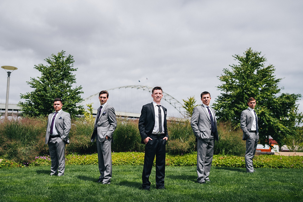 groom and groomsmen standing