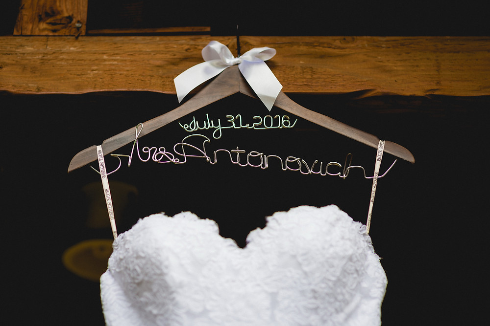 bride's dress with a hanger and the wedding date
