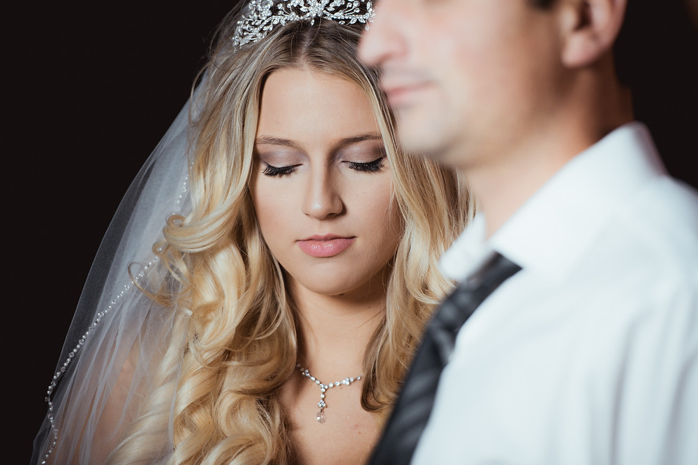 artistic portrait of bride and groom