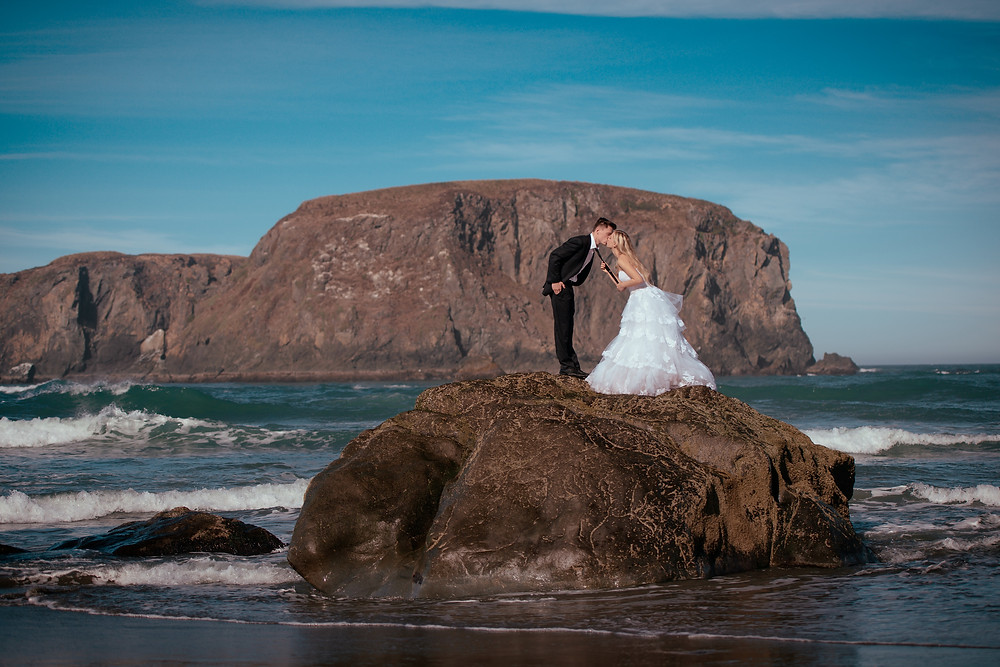 people and landscape photography, bride and groom on a rock