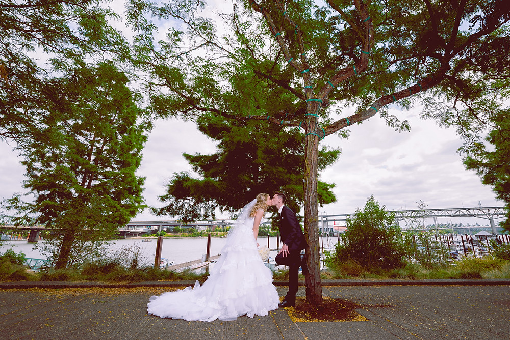 Bride and Groom at the River place Marina in Portland Oregon