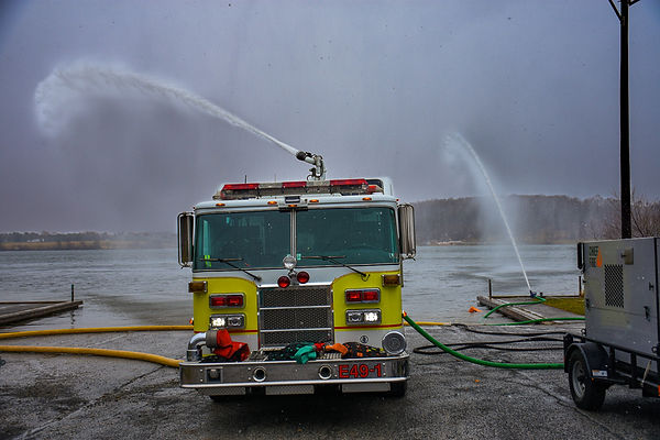 Otter pump flowing 2,000 GPM to a fire engine.