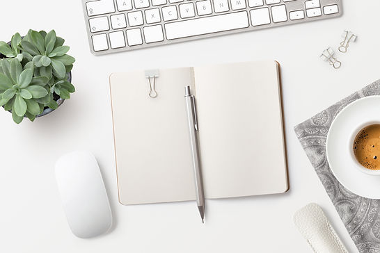 Notepad on Desk with plant an coffee