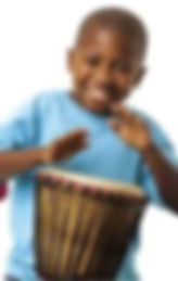 Boy playing djembe drum in a drum circle.