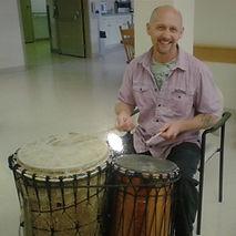 drumcircle facilitator playing african drums