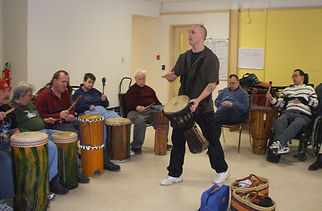 Drum circle facilitation for participants with disabilities. Using African djembe, ashiko and djun drums.
