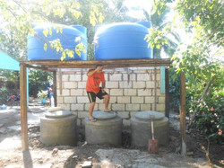 Fr. Carlos with the cisterns-ready for water!!!