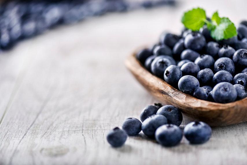 Blueberry on white wooden table. Blueber