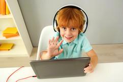 kid on tablet.jpg