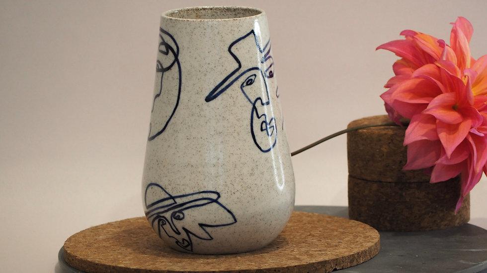 Four Face Vase