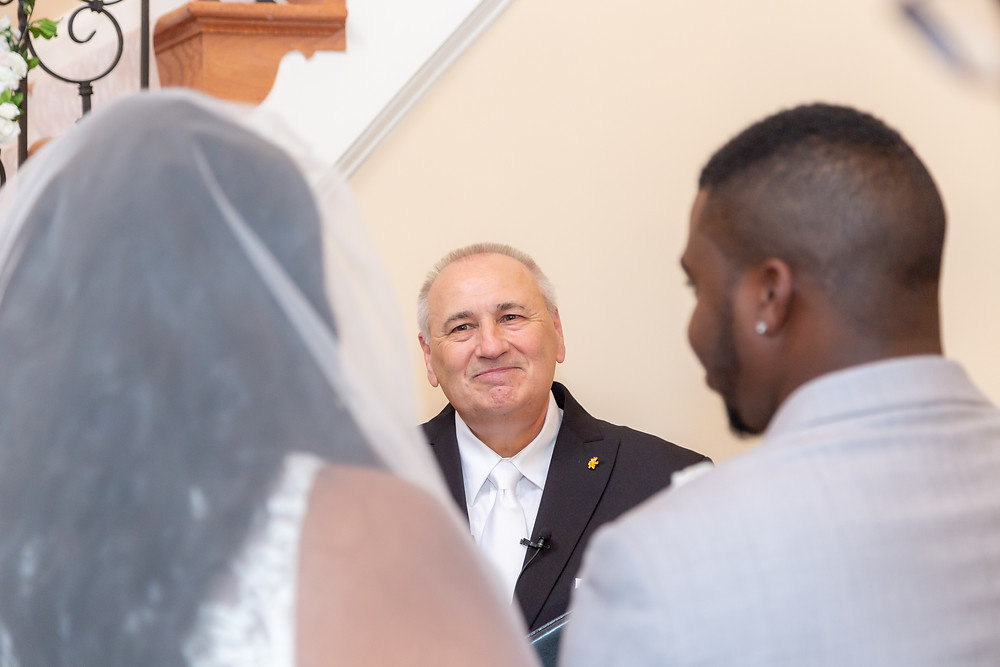 The pastor sharing words of knowledge with the couple during the ceremony in Fairfax, Virginia.