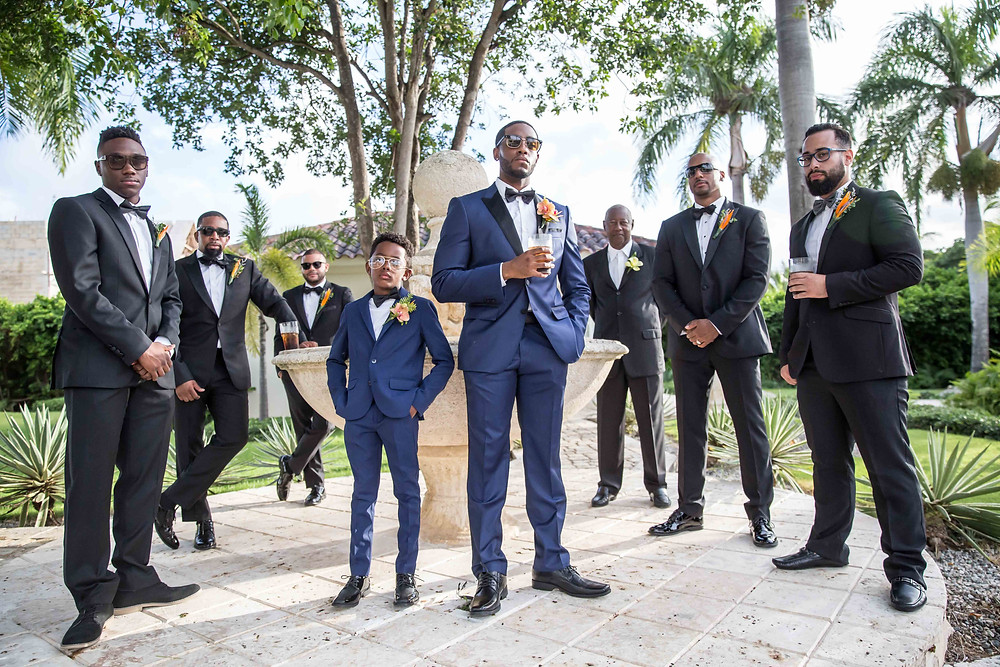 The groom and groomsmen posing for a portrait before the destination wedding in Punta Cana, Dominican Republic.