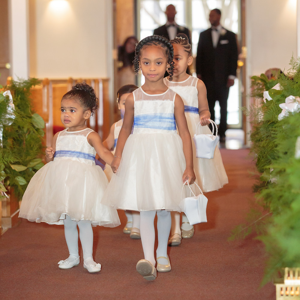 The flower girls and junior bridesmaids walking down the isle to the alter at the Alfred Street Baptist church in Alexandria, Virginia.